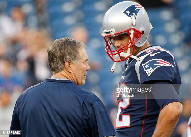 Bill Belichick of the New England Patriots and Tom Brady chat before a preseason game with the New York Giants at Gillette Stadium on August 31 2017...