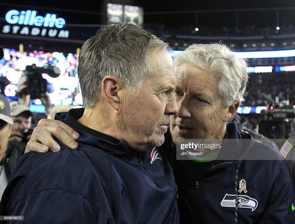 Bill Belichick of the New England Patriots congratulates Pete Carroll of the Seattle Seahawks after a Seahawks win at Gillette Stadium on November 13, 2016 in Foxboro, Massachusetts. (Photo by Jim Rogash/Getty Images) Bill Belichick; Pete Carroll