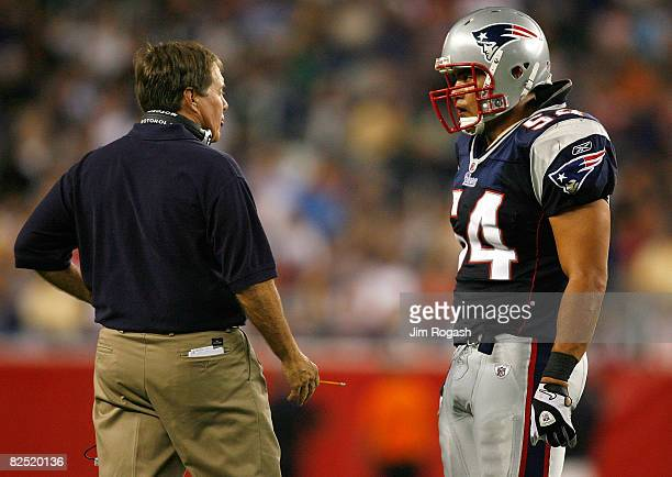 Bill Belichick of the New England Patriots has words with team member Tedy Bruschi during a preseason game against the Philadelphia Eagles at...