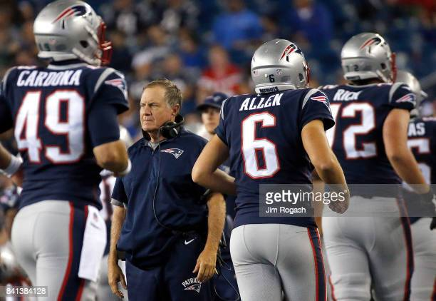 Bill Belichick of the New England Patriots watches the action against the New York Giants in the second half during a preseason game on August 31...