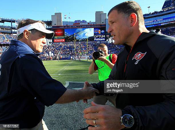 Bill Belichick of the New England shakes hands with Greg Schiano of the Tampa Bay Buccaneers at their end of their game at Gillette Stadium on...