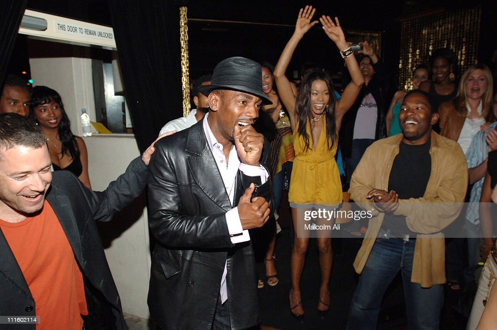 Bill Bellamy (center) when surprised over his 40th birthday celebration with guests