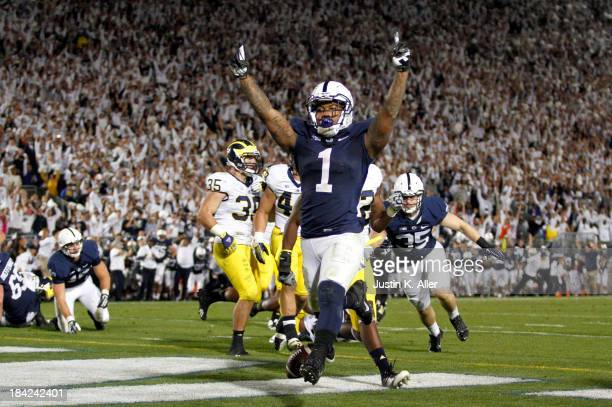 Bill Belton of the Penn State Nittany Lions celebrates after rushing for the game winning touchdown against the Michigan Wolverines during the game...