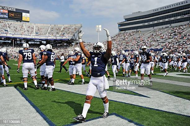 Bill Belton of the Penn State Nittany Lions football team pumps up the crowd before playing the Ohio Bobcats at Beaver Stadium on September 1 2012 in...
