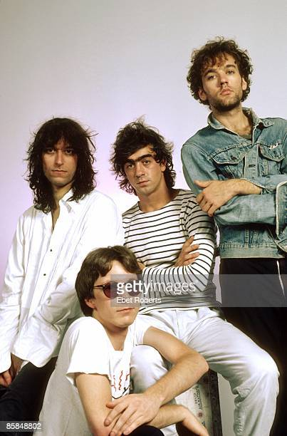 Photo of Bill BERRY and Michael STIPE and Peter BUCK and Mike MILLS and REM LR Peter Buck Mike Mills Bill Berry Michael Stipe posed studio group shot