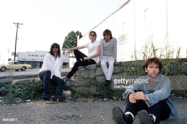 Photo of Bill BERRY and Michael STIPE and Peter BUCK and Mike MILLS and REM LR Peter Buck Mike Mills Bill Berry Michael Stipe posed group shot