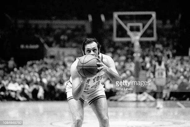 Bill Bradley #24 Forward of the New York Knicks prepares to shoot a foul shot against the Buffalo Braves during an NBA basketball game in Madison...