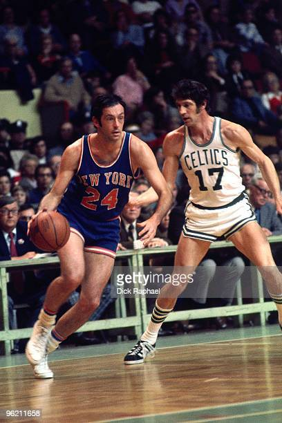 Bill Bradley of the New York Knicks moves the ball against John Havlicek of the Boston Celtics during a game played in 1973 at the Boston Garden in...