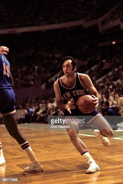 Bill Bradley of the New York Knicks moves the ball up court against the Boston Celtics during a game played in 1972 at the Boston Garden in Boston...