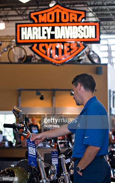 Bill Brandt checks the price tag on a HarleyDavidson motorcycle on the showroom floor at the AD Farrow HarleyDavidson dealership Friday Sept 7 in...