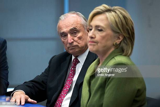 Bill Bratton commissioner of the New York City Police Department looks on as Democratic presidential candidate Hillary Clinton delivers opening...