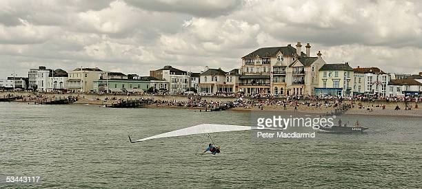 Bill Brooks makes a jump from the pier in the Birdman competition on August 20, 2005 in Bognor Regis, England. The Birdman competition for human...