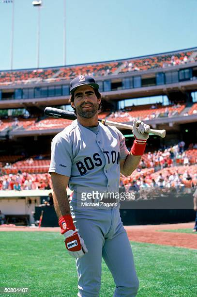 Bill Buckner of the Boston Red Sox stands with a bat prior to a game against the Athletics at OaklandAlameda County Coliseum on July 4 1987 in...