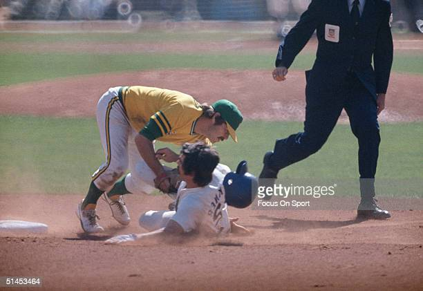 Bill Buckner of the Los Angeles Dodgers slides into second base as Dick Green of the Oakland Athletics applies a tag during the World Series at...
