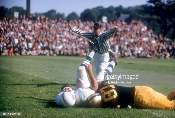 Bill Carpenter of the Army Cadets tackles Dave Kasperian of the Penn State Nittany Lions during an NCAA game on October 4 1958 at Michie Stadium in...