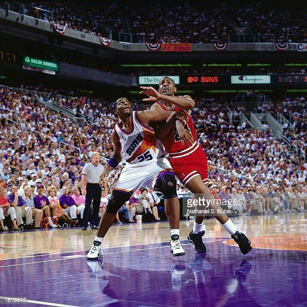Bill Cartwright of the Chicago Bulls battles for position against the Phoenix Suns during Game Six of the 1993 NBA Championship Finals at America...