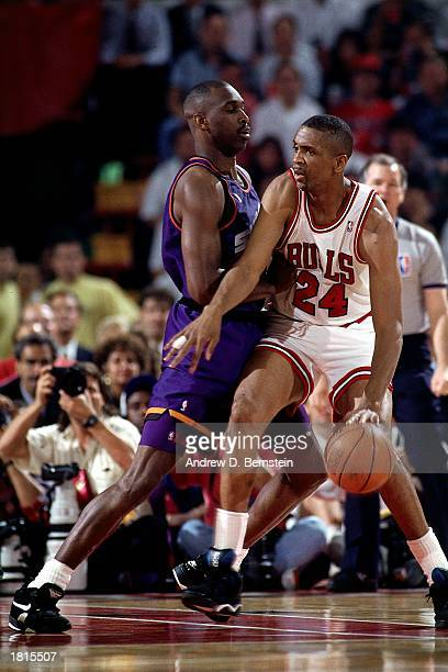 Bill Cartwright of the Chicago Bulls looks to make a play against the Phoenix Suns during Game Five of the 1993 NBA Championship Finals at Chicago...