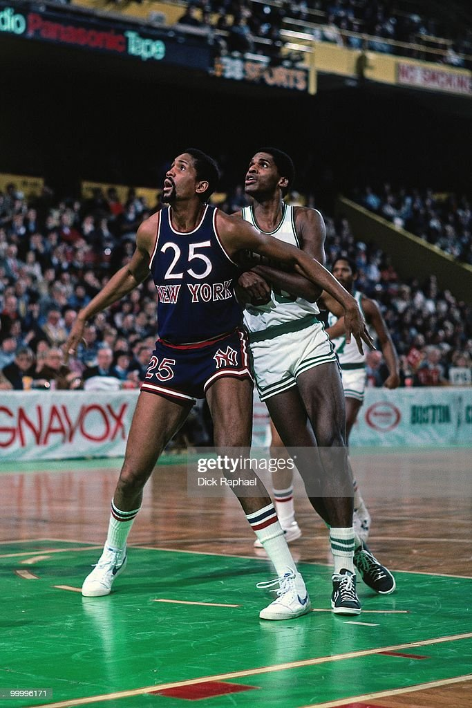 Bill Cartwright #25 of the New York Knicks boxes out against Robert Parish #00 of the Boston Celtics during a game played in 1983 at the Boston Garden in Boston, Massachusetts.