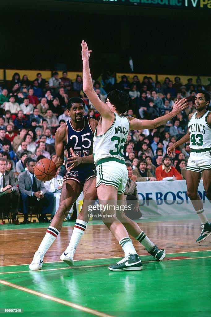 Bill Cartwright #25 of the New York Knicks drives against Kevin McHale #32 of the Boston Celtics during a game played in 1983 at the Boston Garden in Boston, Massachusetts.