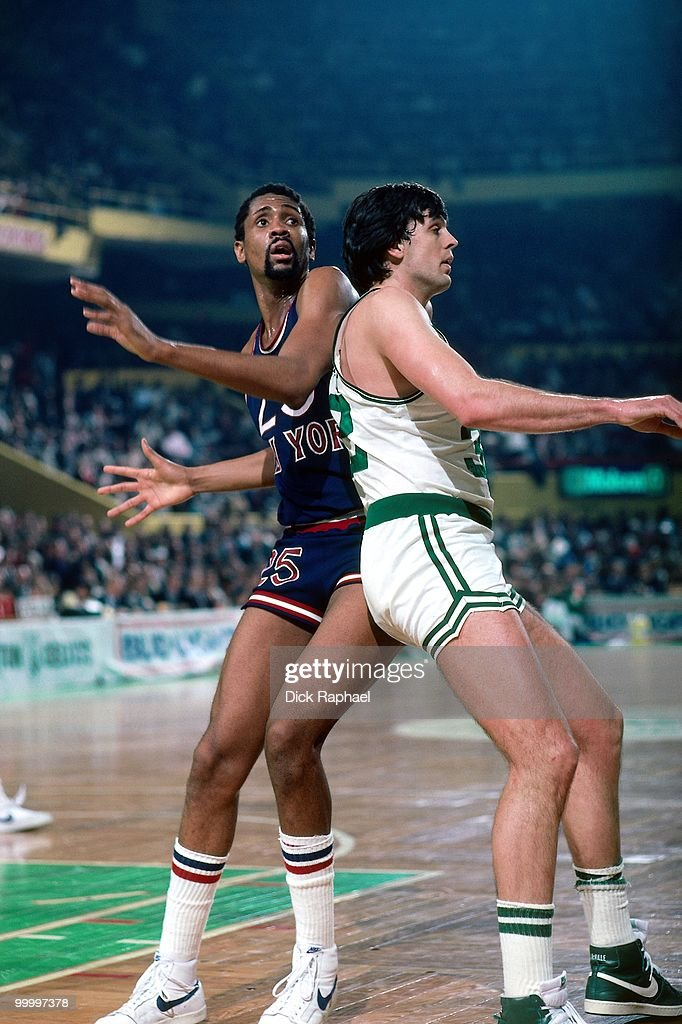Bill Cartwright #25 of the New York Knicks posts up against Kevin McHale #32 of the Boston Celtics during a game played in 1983 at the Boston Garden in Boston, Massachusetts.