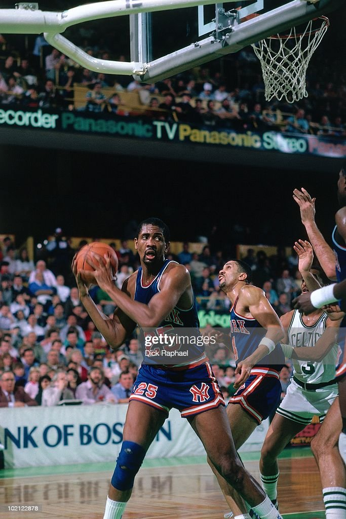 Bill Cartwright #25 of the New York Knicks rebounds against the Boston Celtics during a game played in 1987 at the Boston Garden in Boston, Massachusetts.