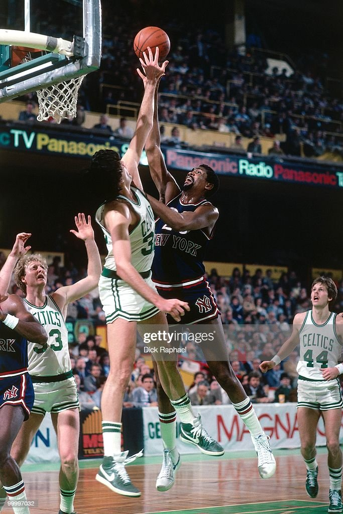 Bill Cartwright #25 of the New York Knicks shoots against Kevin McHale #32 of the Boston Celtics during a game played in 1983 at the Boston Garden in Boston, Massachusetts.