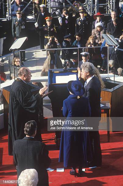 Bill Clinton, 42nd President, takes the Oath of Office on Inauguration Day from Chief Justice William Rehnquist on January 20, 1993 in Washington, DC