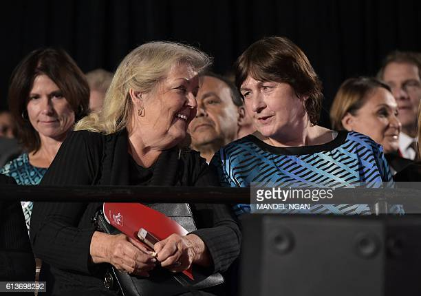 Bill Clinton accuser Juanita Broaddrick chats with rape victim Kathy Shelton as they take their seats for the second presidential debate between...