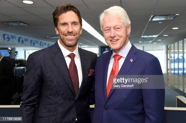 Bill Clinton and Henrik Lundqvist attend Annual Charity Day Hosted By Cantor Fitzgerald BGC and GFI on September 11 2019 in New York City