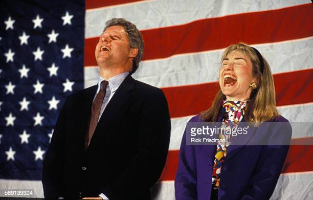 Bill Clinton and Hillary Rodham Clinton laugh as they are about to be introduced at a rally in prior to the New Hampshire primary election