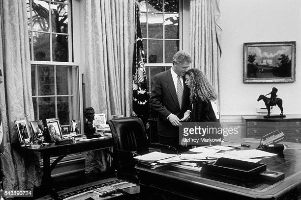 Bill Clinton and his daughter Chelsea in the Oval Office