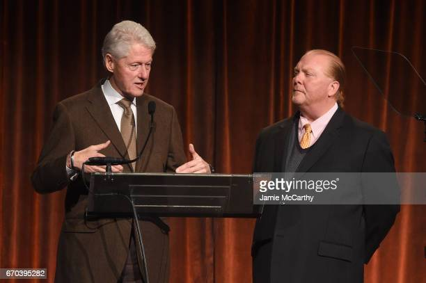 Bill Clinton and Mario Batali speak on stage at the Food Bank for New York City CanDo Awards Dinner 2017 on April 19 2017 in New York City
