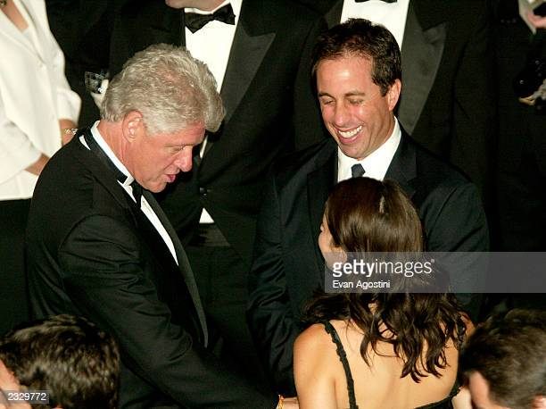 Bill Clinton chatting with Jerry Seinfeld and wife Jessica Sklar at the Juvenile Diabetes Research Foundation Man Of The Year Award benefit honoring...