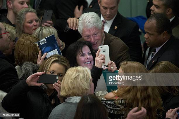 Bill Clinton former US President and husband of Hillary Clinton former Secretary of State and 2016 Democratic presidential candidate center takes a...