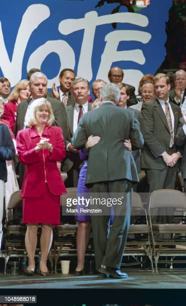Bill Clinton gets a hug from wife Hillary Clinton after he addressed a rally in the Brendan Byrne arena in the Meadowlands East Rutherford New Jersey...