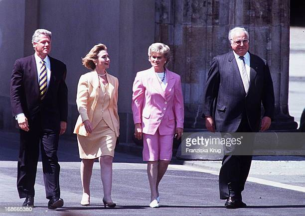 Hillary Clinton and and Hannelore Kohl Helmut Kohl walking through the Brandenburg Gate
