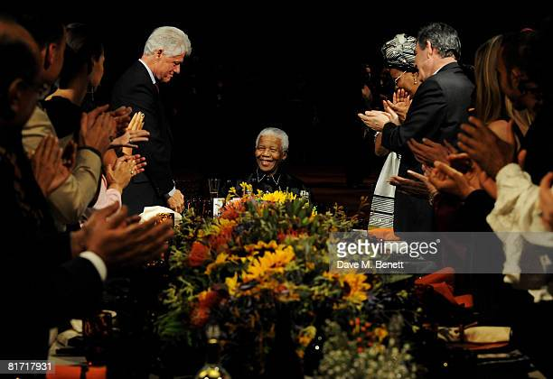 Bill Clinton Nelson Mandela and Gordon Brown attend the dinner in honour of Nelson Mandela celebrating his 90th birthday at Hyde Park on June 25 2008...