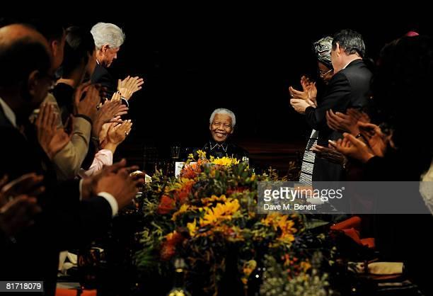 Bill Clinton, Nelson Mandela and Gordon Brown attend the dinner in honour of Nelson Mandela, celebrating his 90th birthday, at Hyde Park on June 25,...
