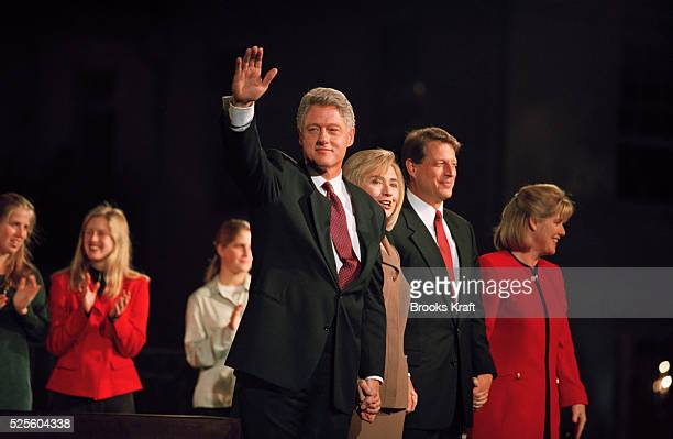 Bill Clinton waves to supporters flanked by his wife Hillary Clinton and Al Gore following Clinton's victory in the 1996 US Presidential elections.