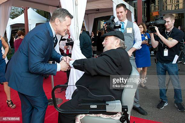 Bill Cody greets Mac Wiseman as he arrives at the 2014 Country Music Hall of Fame induction ceremony at Country Music Hall of Fame and Museum on...
