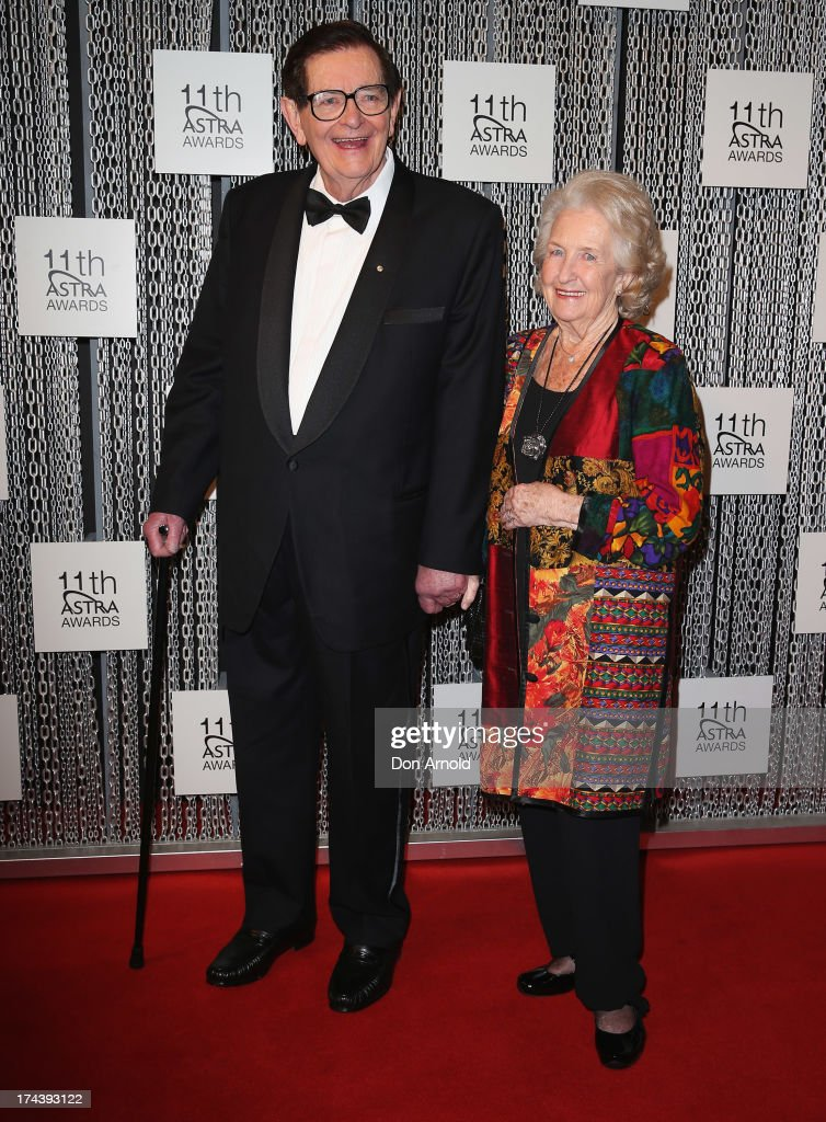 Bill Collins and Joan Collins arrive at the 11th Annual ASTRA Awards at Sydney Theatre on July 25, 2013 in Sydney, Australia.