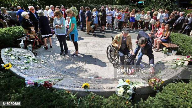 Bill Connors in wheelchair pays respects to his brother Kevin Connors a victim of the 9/11/2001 terrorist attacks with the help of his nephew William...