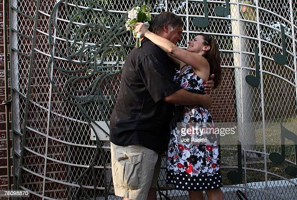 Bill Corelle and Patti Corelle from Derry New Hampshire embrace after being married at the front gates to the Graceland Mansion home of Elvis Presley...