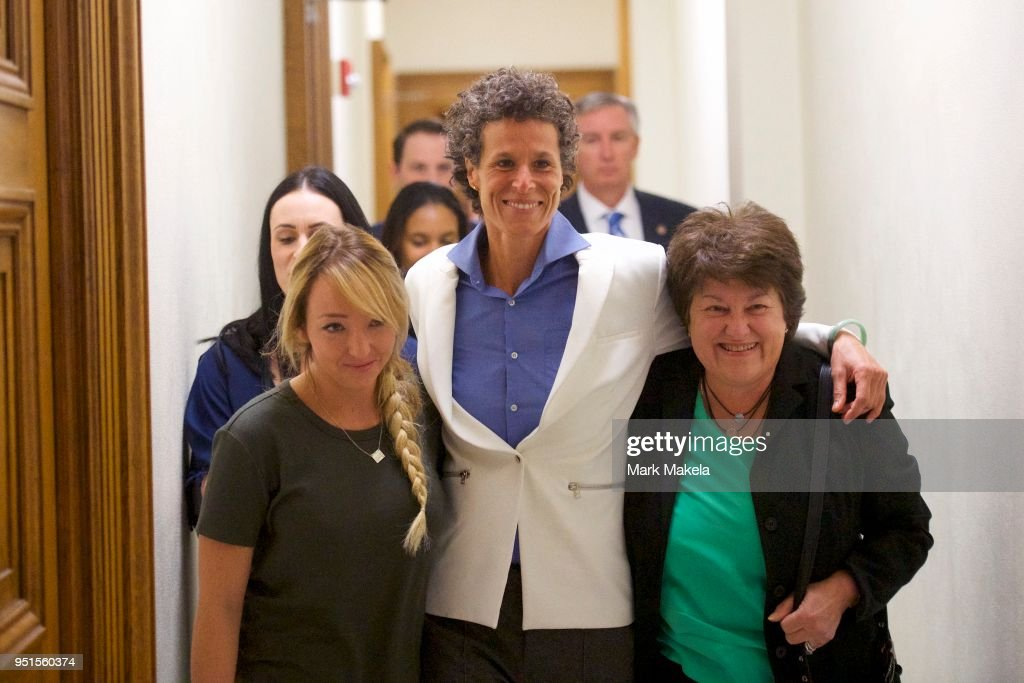 Bill Cosby accuser Andrea Constand (C) reacts with lawyer Dolores Troiani (R) and Delaney Henderson (L) after the guilty on all counts verdict was delivered in the sexual assault retrial at the Montgomery County Courthouse on April 26, 2018 in Norristown, Pennsylvania. Cosby was found guilty on all accounts after a former Temple University employee alleges that the entertainer drugged and molested her in 2004 at his home in suburban Philadelphia. More than 40 women have accused the 80 year old entertainer of sexual assault.