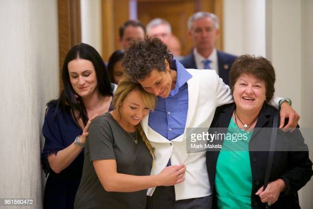 Bill Cosby accuser Andrea Constand reacts with lawyer Dolores Troiani and Delaney Henderson after the guilty on all counts verdict was delivered in...