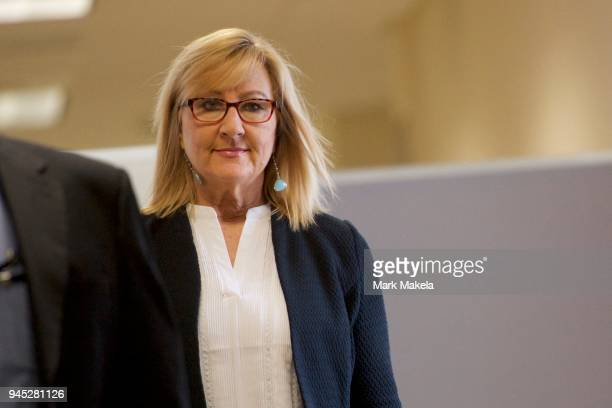 Bill Cosby accuser Janice Baker-Kinney walks towards the courtroom to testify in the Montgomery County Courthouse for the fourth day of the sexual...