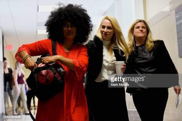 Bill Cosby accuser Lili Bernard and grief counselor Caroline Heldman react after he was sentenced to 3-10 years in the assault retrial at the...