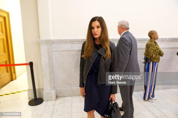 Bill Cosby accuser model Janice Dickinson exits the courtroom for lunch at the Montgomery County Courthouse on the second day of sentencing in Bill...