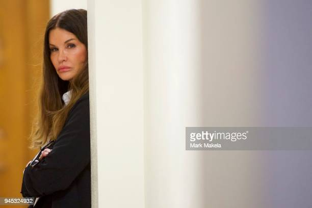 Bill Cosby accuser model Janice Dickinson waits outside a courtroom in the Montgomery County Courthouse before testifying on the fourth day of the...