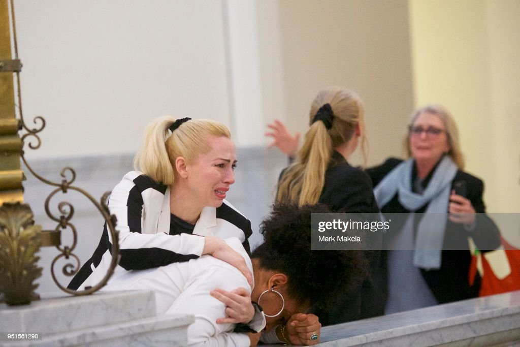 Bill Cosby accusers (L-R) Caroline Heldman, Lili Bernard and Victoria Valentino (far right) react after the guilty on all counts verdict was delivered in the sexual assault retrial at the Montgomery County Courthouse on April 26, 2018 in Norristown, Pennsylvania. Cosby was found guilty on all accounts after a former Temple University employee alleges that the entertainer drugged and molested her in 2004 at his home in suburban Philadelphia. More than 40 women have accused the 80 year old entertainer of sexual assault.
